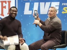 Warner receives a surprise phone call from Tom Brady during NFL UK show