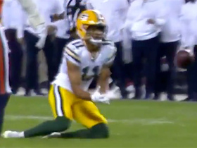 Trevor Davis drops to a knee to reel in Rodgers' throw for 28 yards
