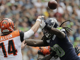 Jadeveon Clowney elevates to deny Andy Dalton's screen pass