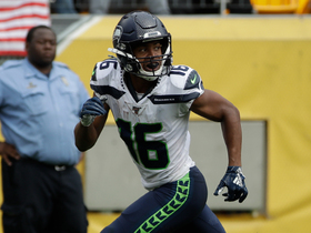 Lockett slips would-be tackler in the flat for 22-yard catch and run