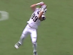 Higbee high-points leaping grab with defender in sight