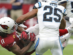 Larry Fitzgerald hangs on for tough 23-yard grab over the middle