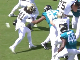 Calais Campbell punches ball out from Alvin Kamara's hands