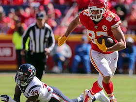 Travis Kelce looks like Spider-Man as he flies through would-be tacklers