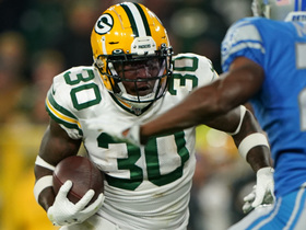 Jamaal Williams stiff arms defender to the turf en route to TD