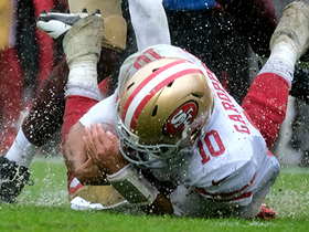 Jimmy Garoppolo hydroplanes on slick turf after run up the middle
