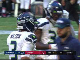 Tyler Lockett reels in Wilson pass for a first down