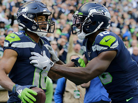 Tyler Lockett corrals over-the-shoulder grab in the corner for second TD