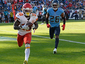 Tyreek Hill climbs into the stands after toasting Titans' D for TD