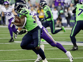 Chris Carson shrugs off Watts on powerful run up the middle