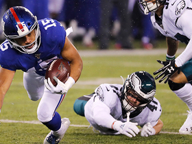 Golden Tate somehow hangs onto catch after being upended